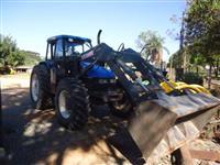 Trator Ford/New Holland TL 100  com concha Baldan 4x4 ano 02