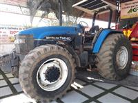 Trator New Holland TM 140 4x4 ano 03