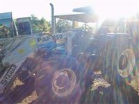 Trator Ford/New Holland TL95 4x4 ano