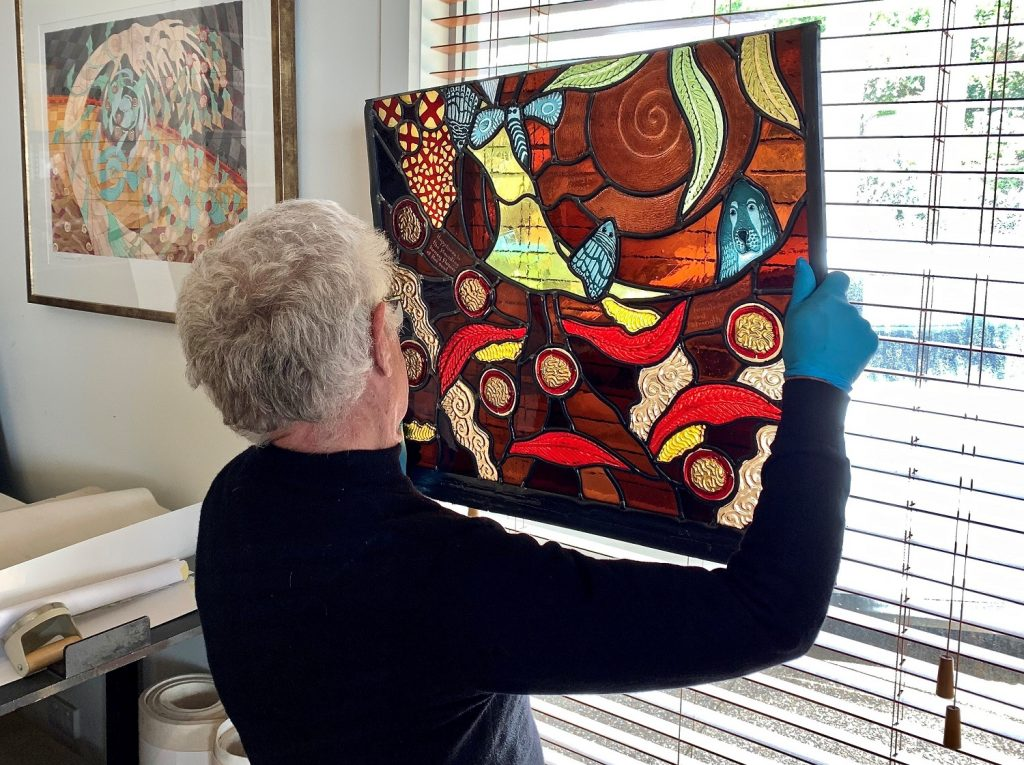 The Artist inspecting his work