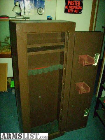this is a very nice metal gun cabinet it holds 8 guns and has double locks theres a top shelf and 2 trays on the door it is in great shape