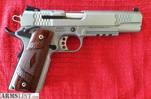 LNIB stainless 1911 TA E series,less than 200 rounds down the pipe.All original factory equiptment included.