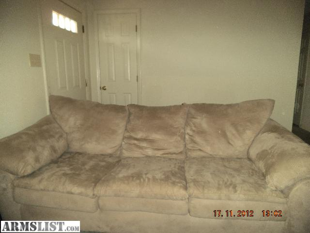 really nice tan microfiber couch no rips or holes i want to trade it for a shotgun or a pistol pretty open for a trade let me know redacted