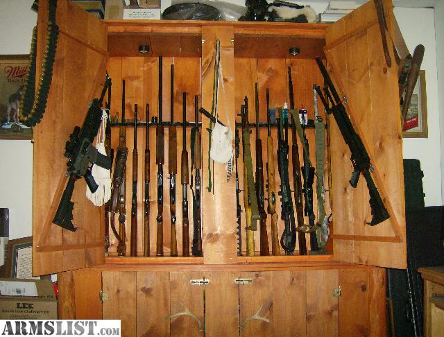 Marvelous Large Cabinet Holds 21 Rifles 6ft Wide 7 Ft Tall Will Fit 50cal Ammo Cans  10 Wide And 3 High With Lights In The Top Half Realy Nice Cabinet