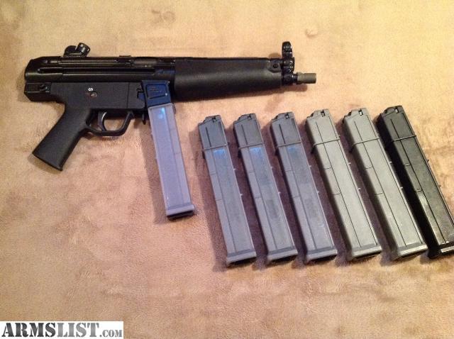 Smith & Wesson 1076 Handgun and Heckler & Koch MP5/10 Submachine ...
