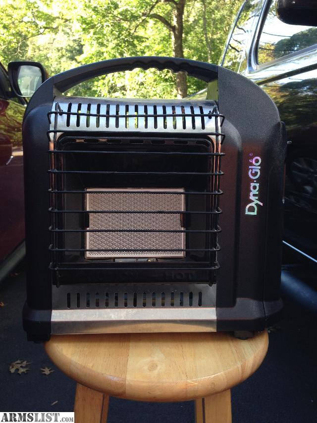 small portable propane heater same as heater buddy uses small propane canisters an has a high or low setting on it will up load pics asap or can send them