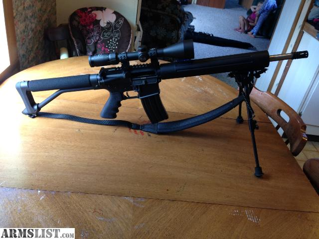 simmons 8 point. stag arms ar15, has 16 inch stainless steel barrel, $350 timney trigger, free floating hand guard, comes with simmons 8 point, 3x9x40 scope, bipod, case, point