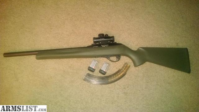 simmons red dot scope. remington 597 hb with two 10 round mags and one 25 mag....simmons 1x20 red dot scope....and original rifle box..100 rounds of ammo...gun lock. simmons scope m