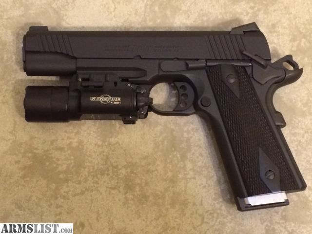 Colt 1911 Rail Gun - Surefire X300 Raven Concealment