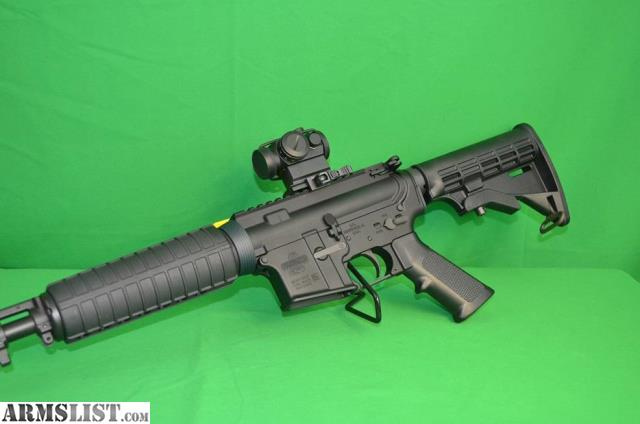 ARMSLIST - For Sale: BUSHMASTER QRC W/RED DOT