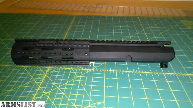 Side charge bolt carrier with a matching side charging stripped upper