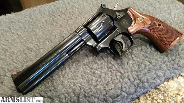 Smith Wesson Model 586 8 357 Magnum 6 Barrel Like New Not A Mark On It Shot Less Than 75 Rounds Come With Box And All The Paper Work Lock