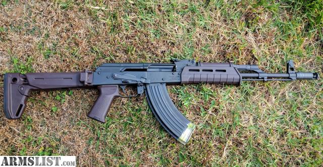 Great Up For Sale Is My WASR 10. It Has Had 20 Rounds Through It Total. I Ditched  The Cheap Wood And Put Plum Magpul Furniture On It.