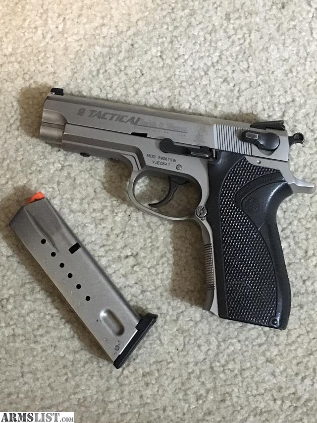 Smith and Wesson S&W 5906 Tactical 9 Edition 9mm SS Stainless Steel Full  Size 1 - 15 round Magazine. Gun is in very good clean condition.