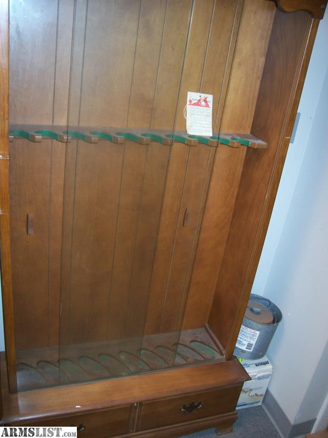 used 10 place solid wood gun cabinet glass and wood in good condition there are no locks for glass or drawers felt worn or missing on buttplate end of