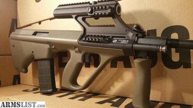 ARMSLIST - For Sale: AUG Steyr Arms with 3 0x Scope accepts AR15