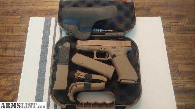 ARMSLIST - For Sale: Glock 19x with tagua holster