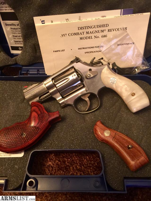 LNiB SW 686 6 Plus 357 Magnum With 2 1 Inch Barrel Gun Has 7 Round Cylinder Red Ramp Front Sight And White Outline Adjustable Rear
