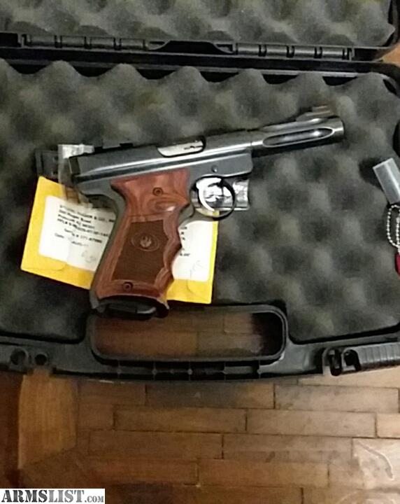 I Have A Blued Ruger Mark Lll Hunter Target Bull Fluted Barrel Grips Box And Savage Mod 93r17hmr With The Laminate Stock Stainless Scope