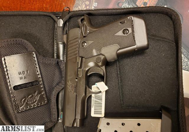 ARMSLIST - For Sale: Kimber Micro 9 Laser Grip Black/ Holster