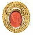 Done in high relief, this red coral cameo is fitted in an incredible 18K yellow gold frame