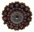 Garnets of various sizes are used in this antique low carat gold brooch