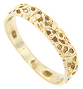 A textured floral design ornaments the top of this 14K yellow gold estate men's wedding band