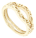 A flowing pattern ornaments the top of these 14K yellow gold curved wedding bands
