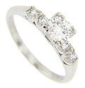 This elegant platinum engagement ring is set with a .58 carat, G color, I1 clarity diamond at the center