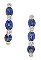 Three faceted oval sapphires and four round diamonds are set in each of these 14K white gold hoop earrings