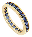 Blue sapphires are set around the entire circumference of this 14K yellow gold estate eternity band