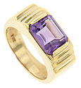 A large emerald cut amethyst crowns the peak of this 14K yellow gold men's estate ring