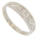 A flower and vine pattern ornaments the top half of this 14K white gold antique style wedding band