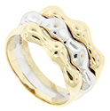 A band of white gold is flanked by bands of yellow gold on this modern 14K gold ring