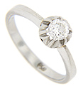 A single diamond is set in a belcher head on this platinum antique engagement ring