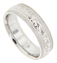 Double milgrain lines border a repeating chevron floral design on this 14K white gold antique style mens wedding band