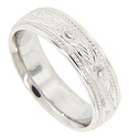 An undulating line is worked down the center of this 14K white gold antique style men's wedding band