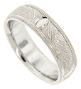 Marquis shapes and mirrored engraving cover the center of this 14K white gold antique style men's wedding band