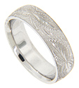 Intricate engraved designs overlay Florentine finish on this 14K white gold antique style men's wedding band