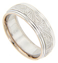 Smoothly polished edges flank a complex engraved design on this 14K white gold antique style men's wedding band