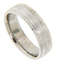 The center of this 14K white gold antique style men's wedding band is simply styled with a matte finish