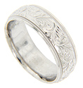 Repeating curved engraved designs decorate this 14K white gold antique style men's wedding band