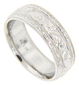 Elaborate engraving graces the surface of this 14K white gold antique style mens wedding band