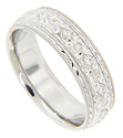 An alternating engraved floral design decorates this 14K white gold antique style men's wedding band