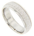 Staggered spiraling designs are engraved around the circumference of this 14K white gold antique style men's wedding band
