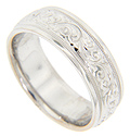 Swooping engraved designs are flanked by simple milgrain edges on this 14K white gold antique style men's wedding band