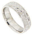 A repeating leaf design is engraved on a matte finish on this 14K white gold antique style men's wedding band