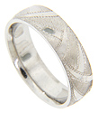 Swooping sections of Florentine finished gold alternate with smoothly polished portions on the surface of this 14K white gold antique style men's wedding band
