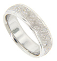 A recurring zig zag design is complemented by texturing on this 14K white gold antique style men's wedding band