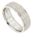 Free-form engraved designs are engraved on the matte surface of this 14K white gold antique style mens wedding band